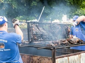 Cooking over the open pit at International Bar-B-Q Festival in Owensboro, Kentucky